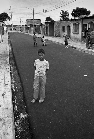 Our young helper. Guayaquil, Ecuador. 2011.