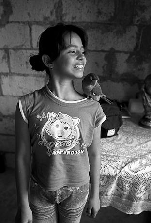 Girl with bird. Guayaquil, Ecuador. 2011.