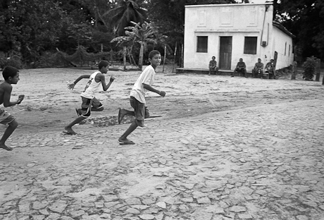 Children running on cobbles. Patacas, Aquiraz - CE, Brazil. 2006.