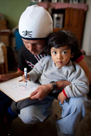 Father and son. Quito, Ecuador. 2006.