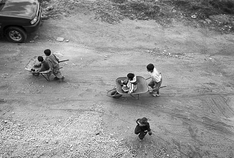 Children playing by church. Quito, Ecuador. 2006.