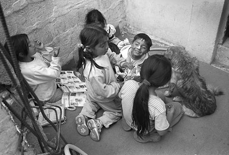 Children playing near church construction. Quito, Ecuador. 2006.