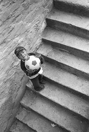 Boy playing ball. Quito, Ecuador. 2006.