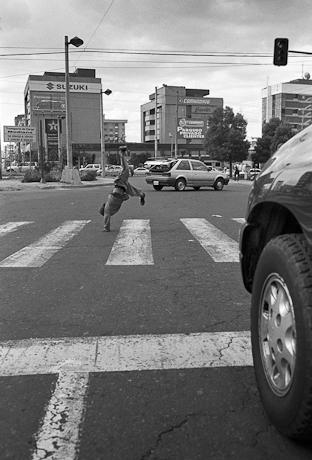 Cartwheels in the road. Quito, Ecuador. 2006.