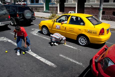 Two street kids juggling. Quito, Ecuador. 2006.