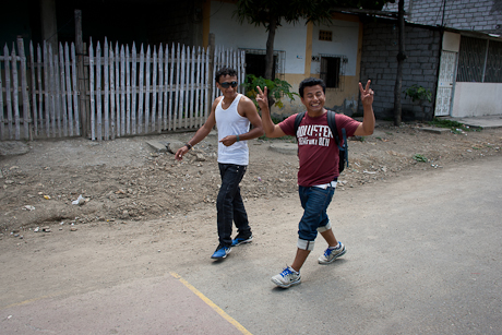 Gabriel (in red) walks through the streets of  the barrios of Guayaquil. 2011.