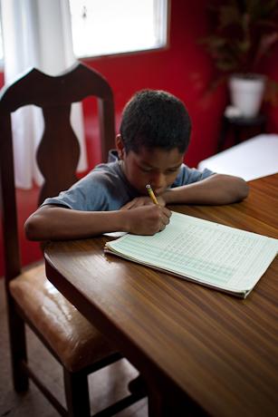 Lalo doing homework. Guayaquil, Ecuador. 2011.