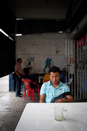Gabriel sits contemplatively. Guayaquil, Ecuador. 2011.