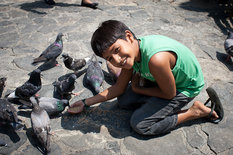 Feeding the birds. Guayaquil, Ecuador. 2011.