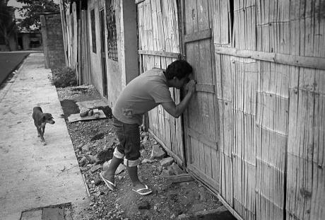Gabriel looks for a friend. Guayaquil, Ecuador. 2011.