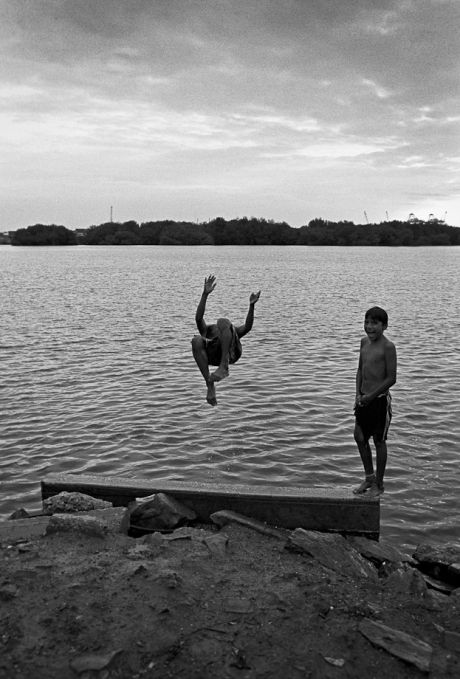 Swimming in the river. Guayaquil, Ecuador. 2011.