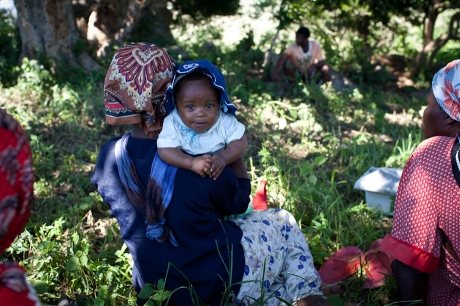 Meeting under a tree and baby. Swaziland. 2005.