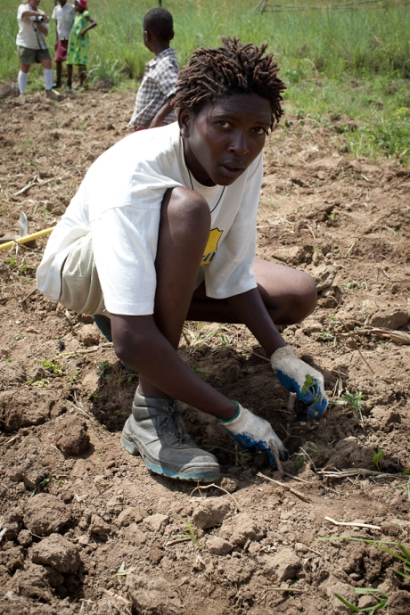 Lungelo Dlamini helps plant in the garden. Swaziland. 2005.