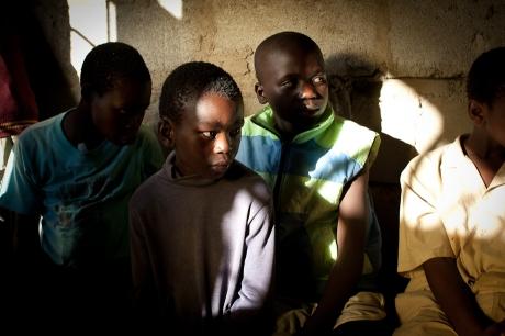 Orphans watch a presentation. Swaziland. 2005.