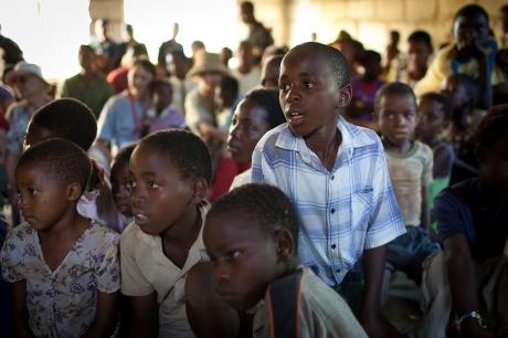 Children watch a magic show. Swaziland. 2005.