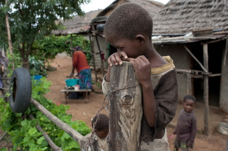 A boy on a fence. Swaziland. 2005.