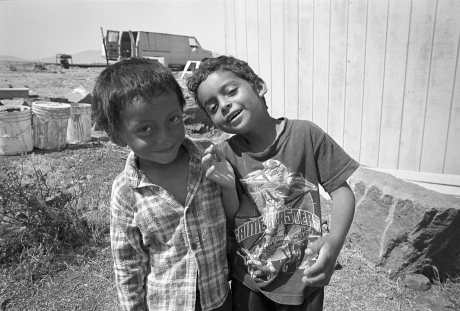Children outside of building site. Mexico. 2006.