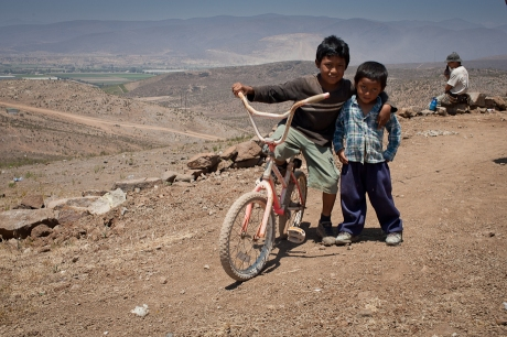 Kids with a bike. Mexico. 2006.